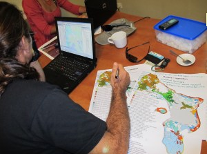 Fernando Simal of STINAPA Bonaire reviewing a vegetation map of Bonaire